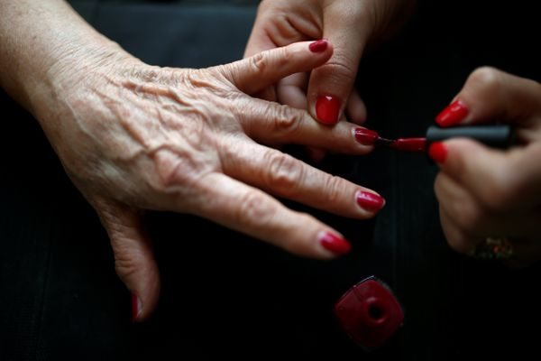 A contestant has nail polish applied before the start of the annual Holocaust survivors' beauty pageant in the Israeli city o