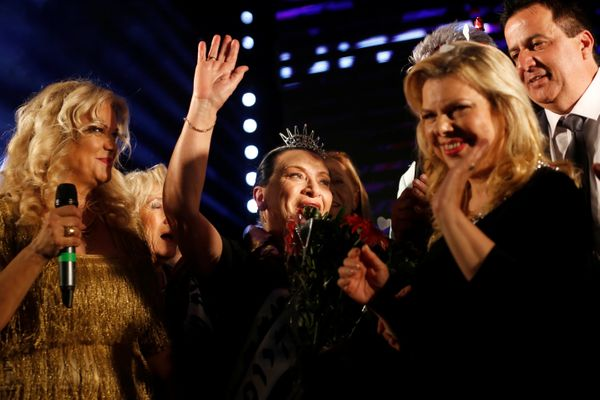 Holocaust survivor Anna Grinis (C), 75, celebrates after winning the annual Holocaust survivors' beauty pageant in the Israel