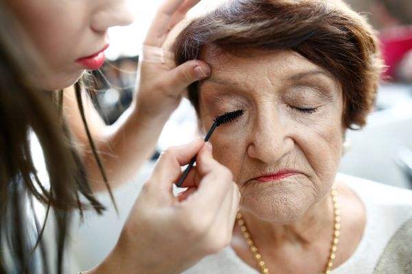 A Holocaust survivor has her make-up done before the start of the annual Holocaust survivors' beauty pageant in the Israeli c