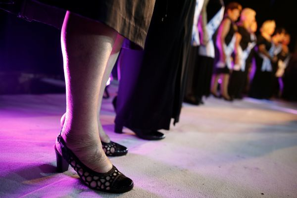 Contestants stand on stage during the annual Holocaust survivors' beauty pageant in the Israeli city of Haifa October 30, 201