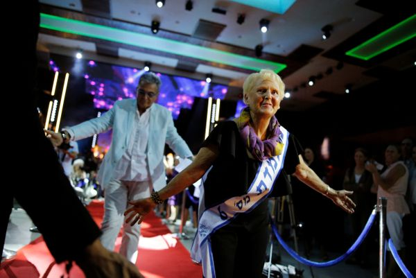 Holocaust survivor, Malka Gurka, 73, walks down a red carpet during the annual Holocaust survivors' beauty pageant in the Isr
