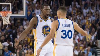 October 25, 2016; Oakland, CA, USA; Golden State Warriors forward Kevin Durant (35) celebrates with guard Stephen Curry (30) against the San Antonio Spurs during the second quarter at Oracle Arena. Mandatory Credit: Kyle Terada-USA TODAY Sports