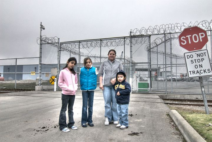 A family outside the Northwest Detention Center in Tacoma, Washington. The facility is run by a private prison contractor for