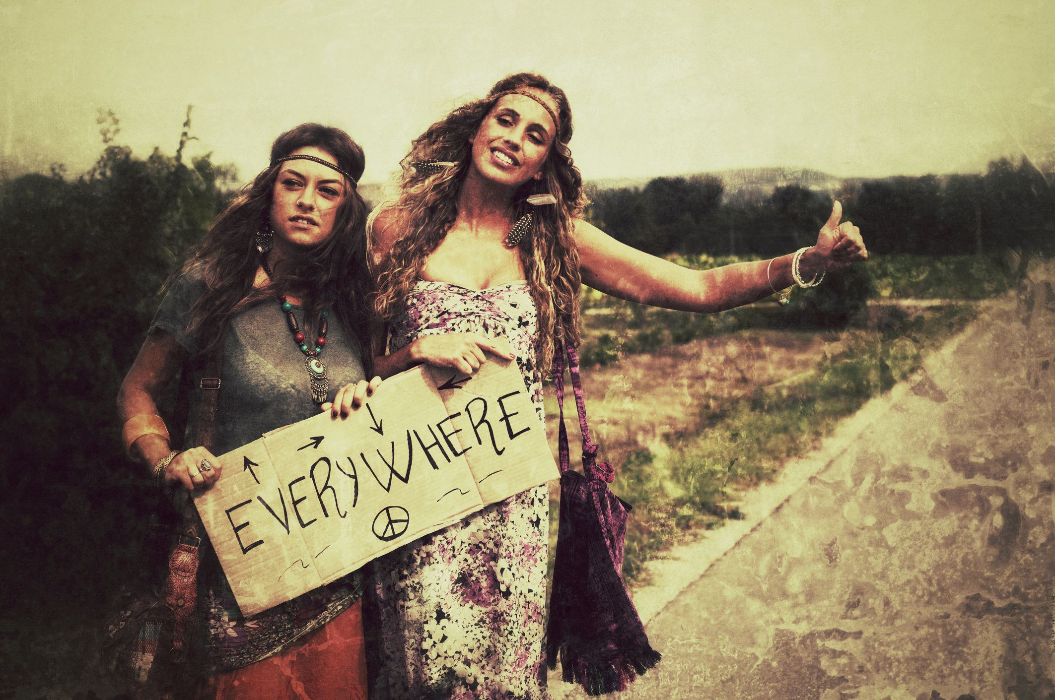 Hitchiking Hippies Women. 1970s style. Age effects added.