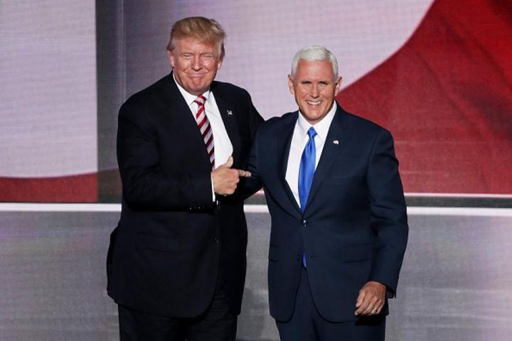 Trump stands with Mike Pence.