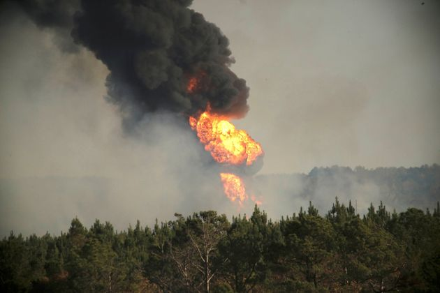 Flames shoot into the sky from a gas line explosion in western Shelby County, Alabama, on