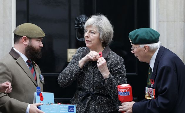 Theresa May, pictured collecting her poppy in Downing Street on Monday, said that 'people should be able...