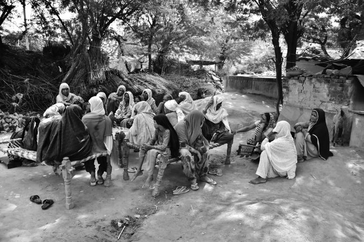 The women of Kherla village in northern India gather to listen to their favorite radio program on Radio Mewat. The community