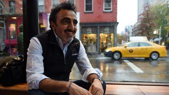 Turkish born Hamdi Ulukaya, CEO of Chobani, pauses as he answers questions during an interview November 17, 2014 in New York.  AFP PHOTO/Don Emmert        (Photo credit should read DON EMMERT/AFP/Getty Images)