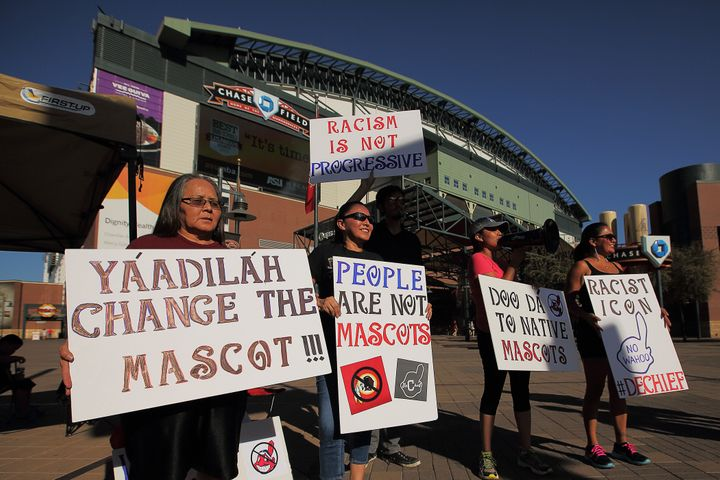 Native American protesters demonstrate against the use of the Chief Wahoo logo before a Cleveland game in Arizona in 2014.