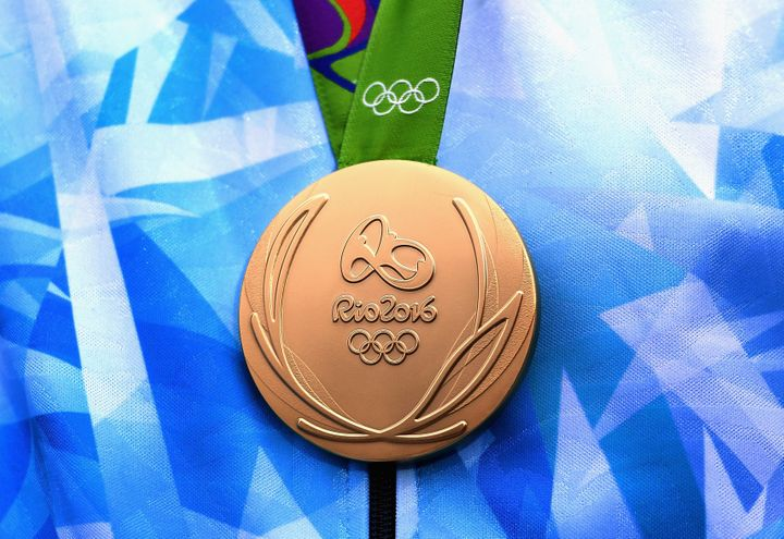 An Argentinan Olympian is seen with his gold medal at the Rio 2016 Olympic Games.