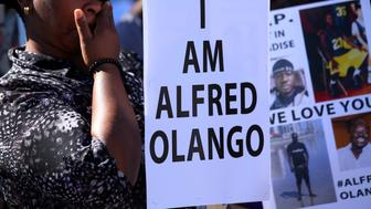 People gather in a park for a rally and march to protest the fatal police shooting of Ugandan immigrant Alfred Olango in El Cajon, California, U.S., October 1, 2016.   REUTERS/Mike Blake