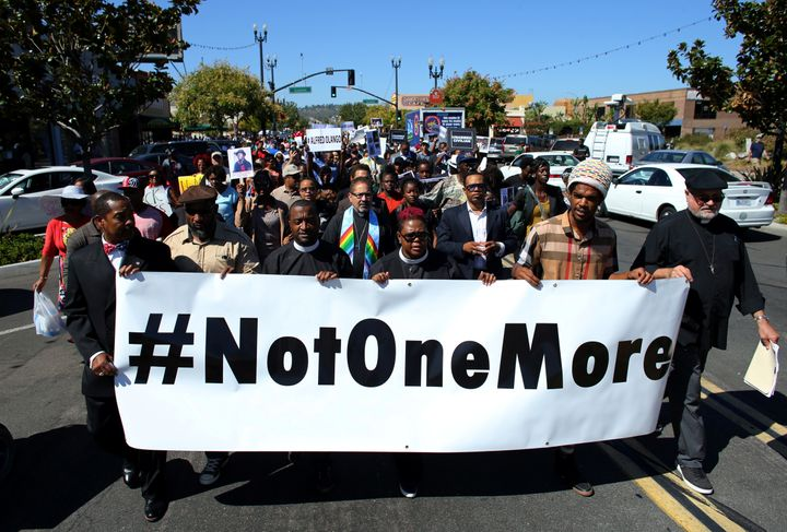 Demonstrators hold a march and rally on October 1 to protest the fatal police shooting of Ugandan immigrant Alfred Olango in