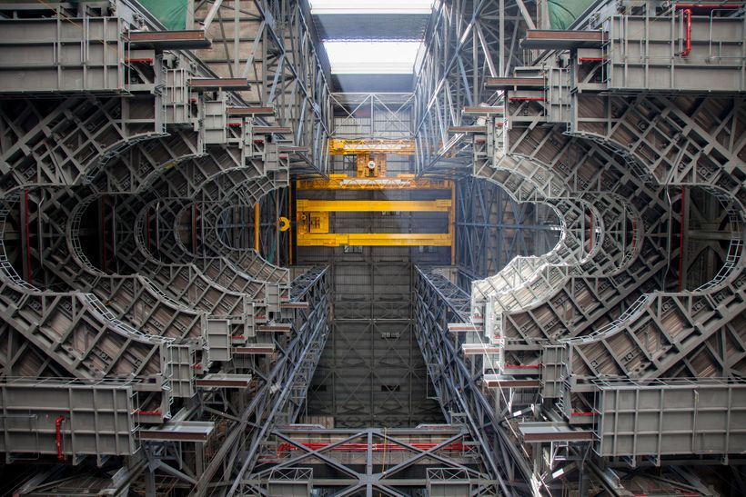 New SLS work platforms line the inside of a former space shuttle bay in the Vehicle Assembly Building at NASA's Kennedy Space