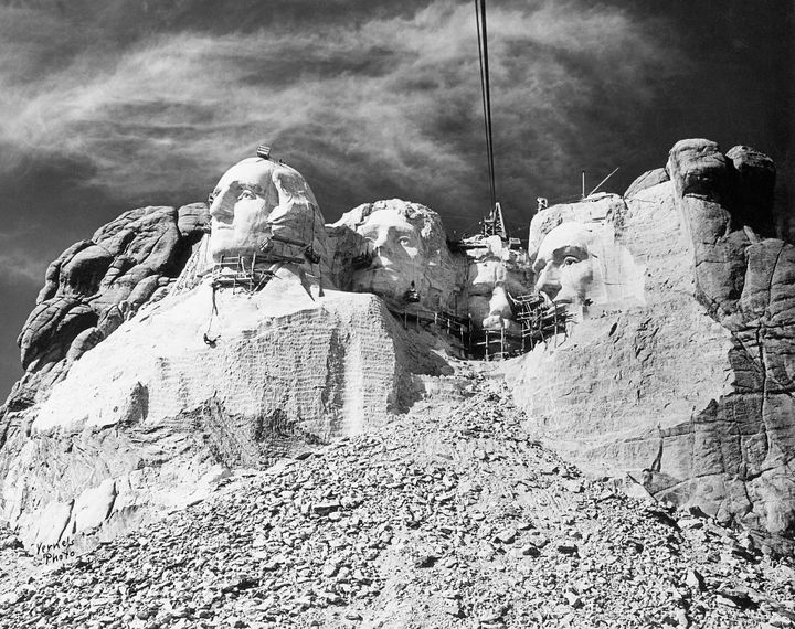Workers in progress at Mount Rushmore, circa 1940.