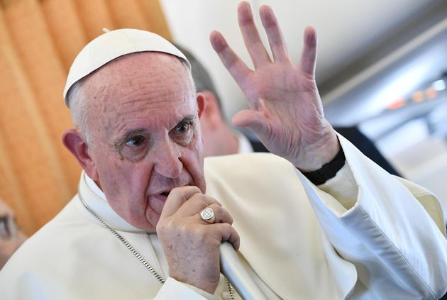 Pope Francis speaks to journalists on his flight back to Rome, Italy Nov.