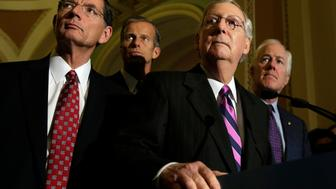 Senate Majority Leader Mitch McConnell (R-KY) (C) listens to questions from the media as Senators John Barrasso(L),R-PA, John Thune(2nd-L), R-SD, and John Cornyn(R), R-TX look on after a policy luncheon on Capitol Hill in Washington, DC on September 27, 2016. / AFP / YURI GRIPAS        (Photo credit should read YURI GRIPAS/AFP/Getty Images)