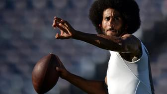 FILE PHOTO - Sep 1, 2016; San Diego, CA, USA;  San Francisco 49ers quarterback Colin Kaepernick throws a pass before the game against the San Diego Chargers at Qualcomm Stadium. Mandatory Credit: Jake Roth-USA TODAY Sports