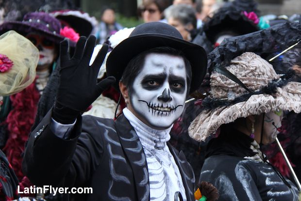 Face painting creativity at Mexico City's first Day of the Dead parade.