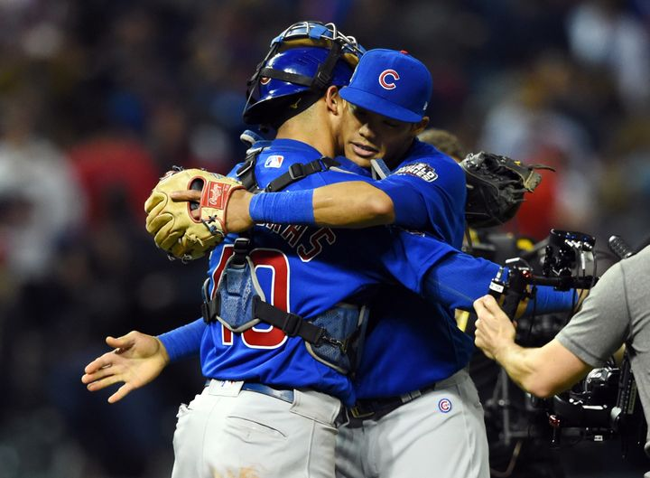 Chicago Cubs players Willson Contreras (40) and Addison Russell celebrate after defeating the Cleveland Indians in game six o