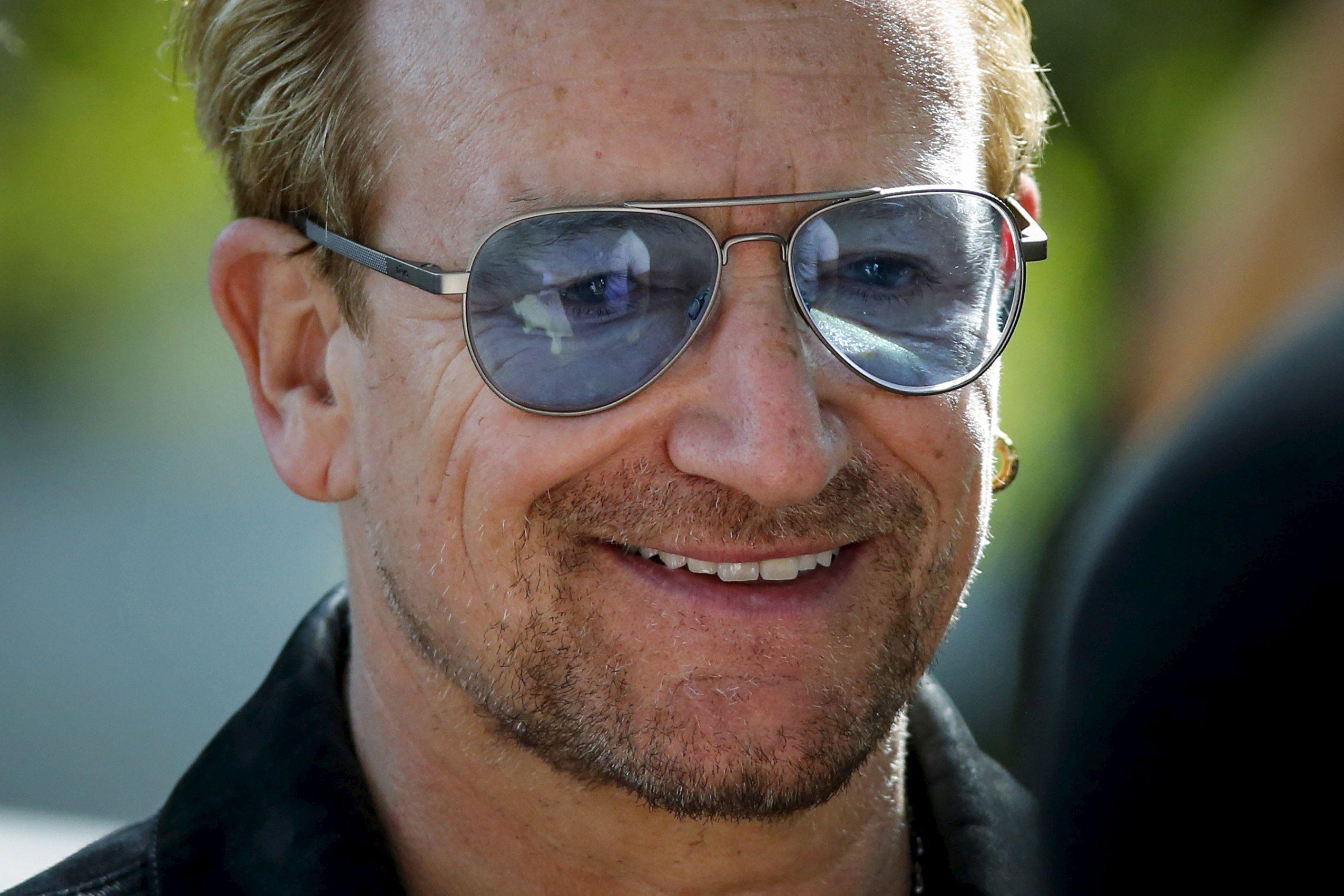 Irish singer Bono attends the unveiling of a tapestry honoring John Lennon at Ellis Island in New York July 29, 2015. REUTERS/Eduardo Munoz