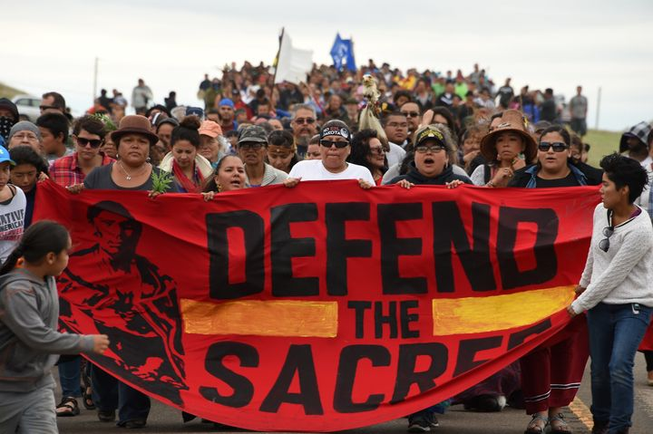 Native Americans march to a burial ground sacred site that was disturbed by bulldozers building the Dakota Access Pipeline.