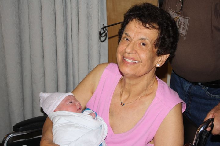 <p>My mother holding Mario after he was born.</p>