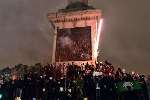 Protestors set off fireworks in Trafalgar Square during last year's Million Mask