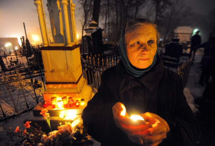 A woman at Kalvaryja, a Catholic Calvary cemetery in Minsk, Belarus, on All Souls' Day.