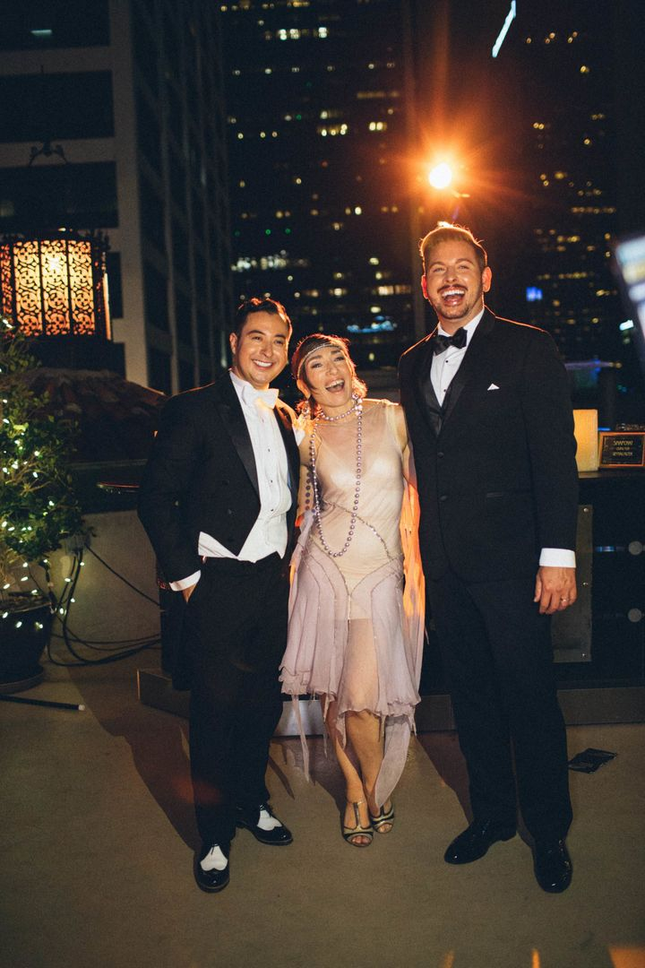 The grooms posing with actress Naomi Grossman who plays Pepper in the miniseries.