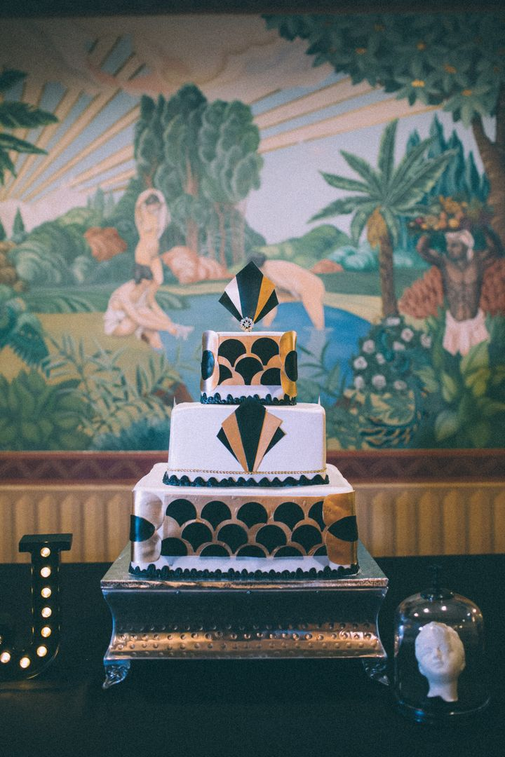 The wedding cake is an Art Deco masterpiece.