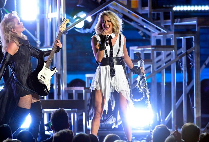 "Carrie performing ""Dirty Laundry"" during the show."