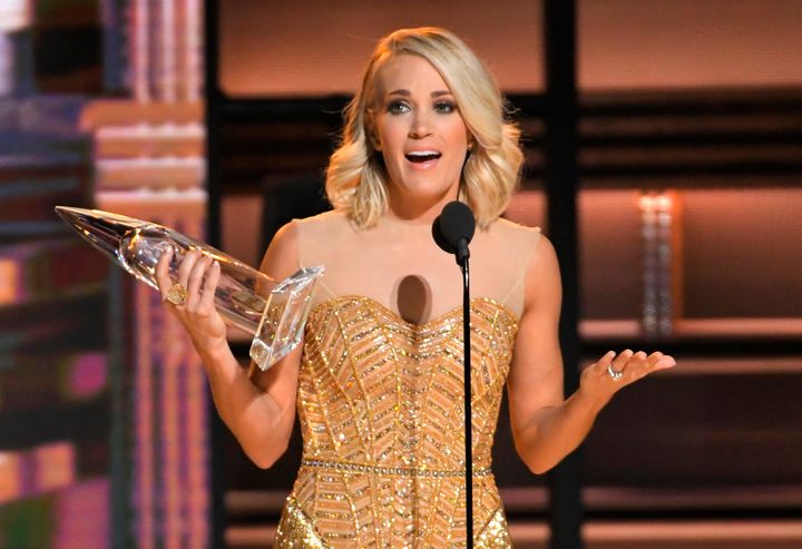 Carrie Underwood accepts the award for female vocalist of the year at the 50th Annual CMA Awards.