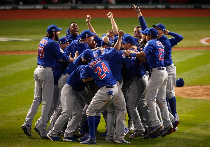 The Chicago Cubs celebrate after defeating the Cleveland Indians 8-7 in Game Seven of the 2016 World Series.
