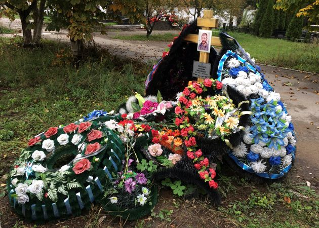 A grave of Russian contractor Maxim Kolganov, who was killed in combat in Syria, is pictured in his hometown...