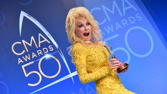 NASHVILLE, TN - NOVEMBER 02:  Dolly Parton poses with award backstage during the 50th annual CMA Awards at the Bridgestone Arena on November 2, 2016 in Nashville, Tennessee.  (Photo by Jason Davis/FilmMagic)