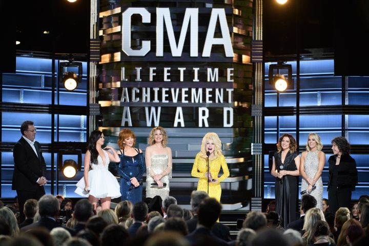 Dolly Parton accepting the Willie Nelson Lifetime Achievement Award at the 2016 CMAs.