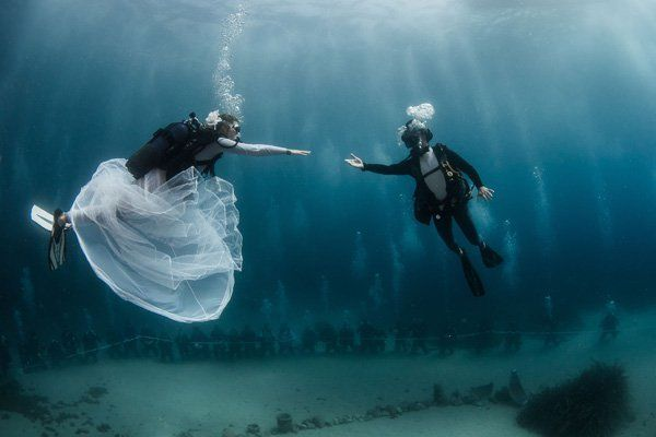 <p><strong>Underwater Wedding at Hôtel Métropole in Monte-Carlo</strong>: Why, hello there, adventure! Anchors away as you swim 400-feet below sea at Monaco's luxe and colorful Larvotto Beach. Your ceremony will be helmed by the famed Pierre Frolla, an award-winning free-diver, and you'll get professional divers and a priest to accompany you and up to 22 guests to witness the underwater ceremony. Once you catch your breath above water, host your reception in the stunning gardens or the bar and pool house designed by the one-and-only Karl Lagerfeld.</p>