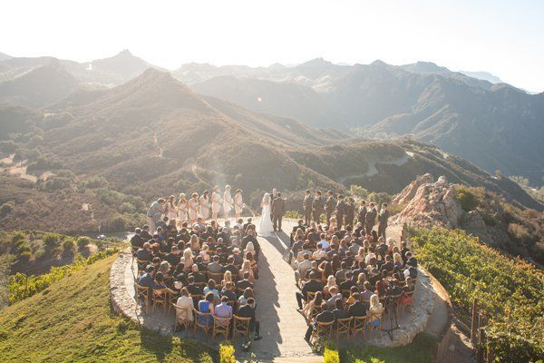 <p><strong>Mountaintop Wedding at Malibu Rocky Oaks in Malibu, California: </strong>Picture this: Sweeping vistas of breathtaking mountains, a picturesque gathering of your closest friends and family members, and a wedding album filled with photos as magical as the views you saw that time you took a sunset helicopter ride. Tucked away in sunny California, this unbelievable venue is also home to diverse and sprawling vineyards.</p>