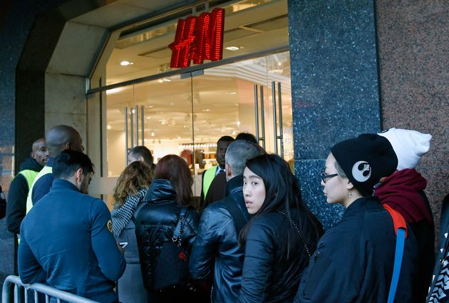 People queue in front of the H&M Haussmann store in Paris on Thursday 3