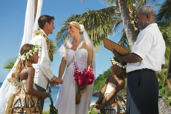 <p><strong>An Authentic Fijian Wedding in Fiji: </strong>When you make Fiji your choice for a destination wedding, it typically follows the authentic Fijian format. 1) The couple gets escorted by warrior(s) dressed in grass skirts (called Liku vau) sporting vesa vau (anklets and armbands), and gumu loa (with their faces and cheeks painted black). 2) The couple can be clad in Fijian wedding costumes (or you can skip it) and 3) Flower girl and boy or both girls (traditionally) sprinkle flowers on the aisle leading up to onto the altar where a choir awaits and sings a moving hymn to kick off the nuptials. </p>
