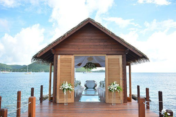 """<p><strong>Overwater Wedding Chapel at Sandals Grande St. Lucian in St. Lucia: </strong>This overwater serenity wedding chapel is sure to dazzle, with its picturesque views and unique crossways for exchanging vows. Tucked away at the edge of the property, the open-air chapel is one-of-a-kind (and the first in the Caribbean) and boasts an enchanted interior complete with a river stone altar that holds up to 20 guests. As you float down the natural-aisle towards saying """"I do,"""" we promise you'll be glad you booked this venue that comes at no extra fee with your wedding package.</p>"""