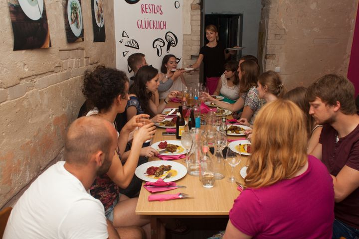 People eating meals made from food waste at the Restlos Glücklich restaurant in Berlin.