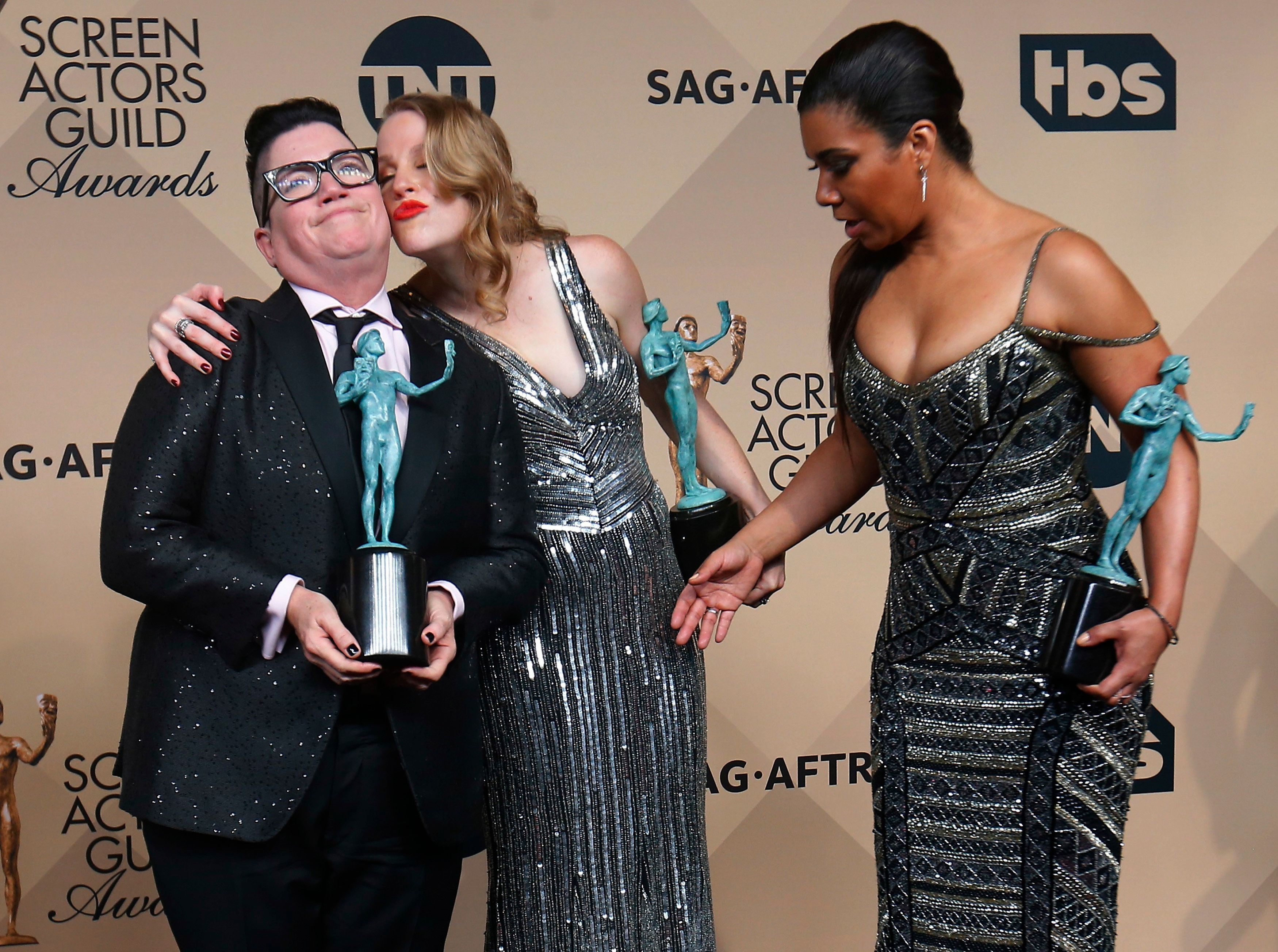 """Actresses Lea DeLaria, Emma Myles and Jessica Pimentel (L to R) of """"Orange is the New Black"""" hold their awards for Outstanding Performance by an Ensemble in a Comedy Series as they pose backstage at the 22nd Screen Actors Guild Awards in Los Angeles, California January 30, 2016.  REUTERS/Mike Blake"""