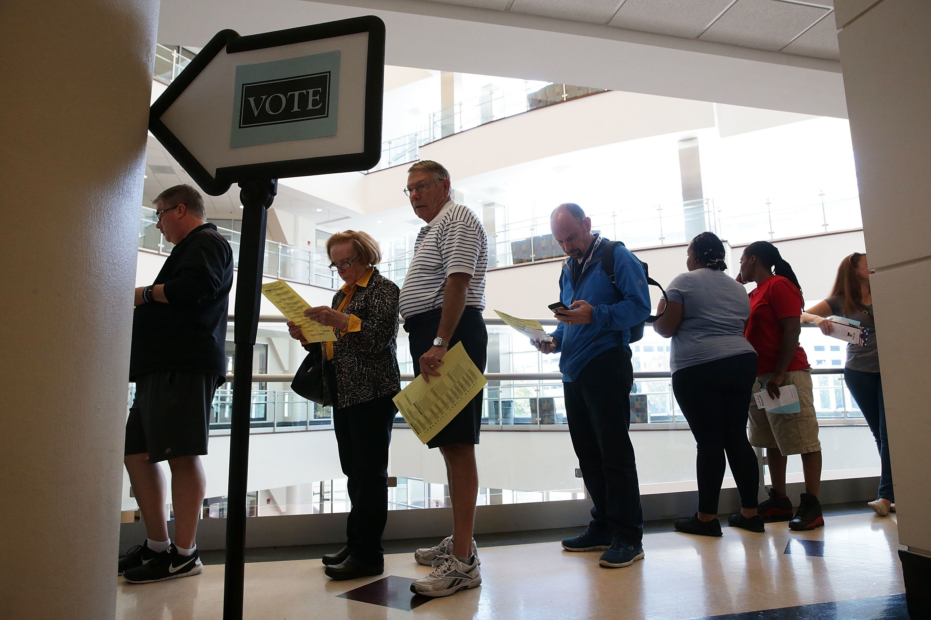WINSTON-SALEM, NC - OCTOBER 28:  Voters wait in line for casting their ballots during early voting for the 2016 general election at Forsyth County Government Center October 28, 2016 in Winston-Salem, North Carolina. Early voting has begun in North Carolina through November 5.  (Photo by Alex Wong/Getty Images)