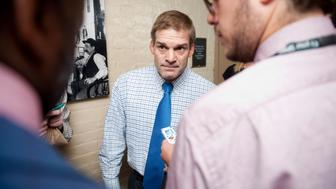UNITED STATES – JULY 29: Rep. Jim Jordan, R-Ohio, stops to speak with reporters as he arrives for the House Republicans' caucus meeting in the basement of the Capitol on Friday, July 29, 2011. (Photo By Bill Clark/Roll Call)