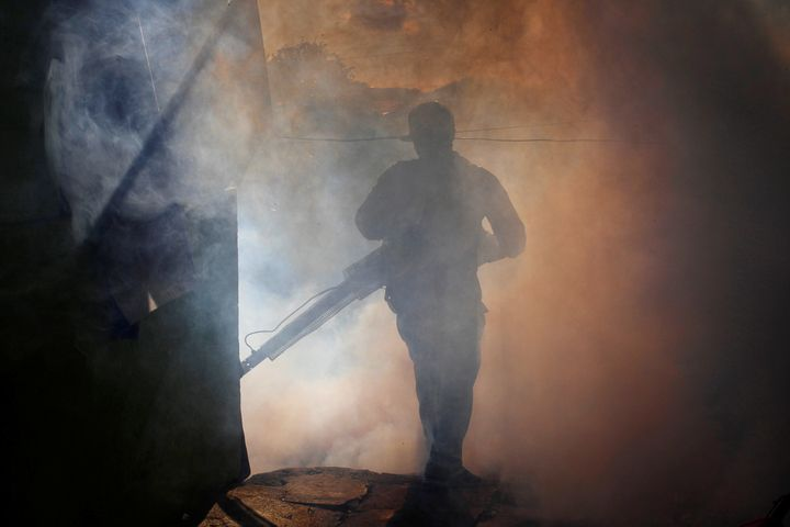 A health ministry worker fumigates a house to kill mosquitoes in Managua, Nicaragua, on Oct. 27.