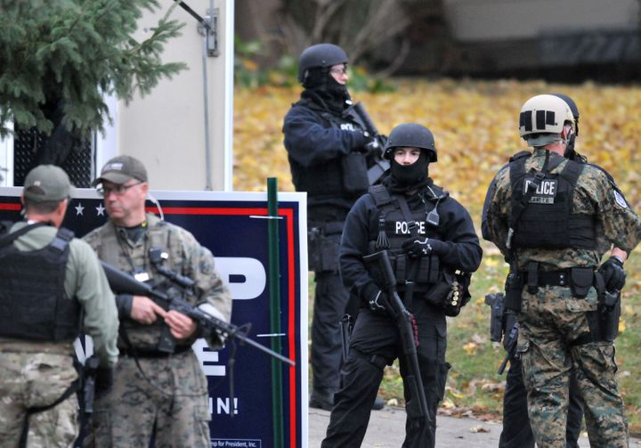 Officers stand guard outside the home of alleged gunman Scott Michael Greene in Urbandale, Iowa, onNov. 2, 2016.