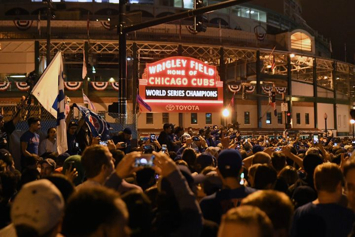 Chicago Cubs fans celebrate after game seven of the 2016 World Series against the Cleveland Indians outside of Wrigley Field.