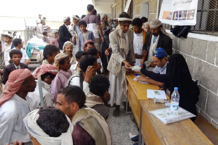 Beneficiary heads of households receive their food vouchers distributed monthly in Haymah Dakhliyah, Sanaa governorate.